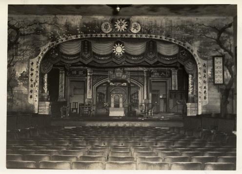 Historic view of the stage and seating